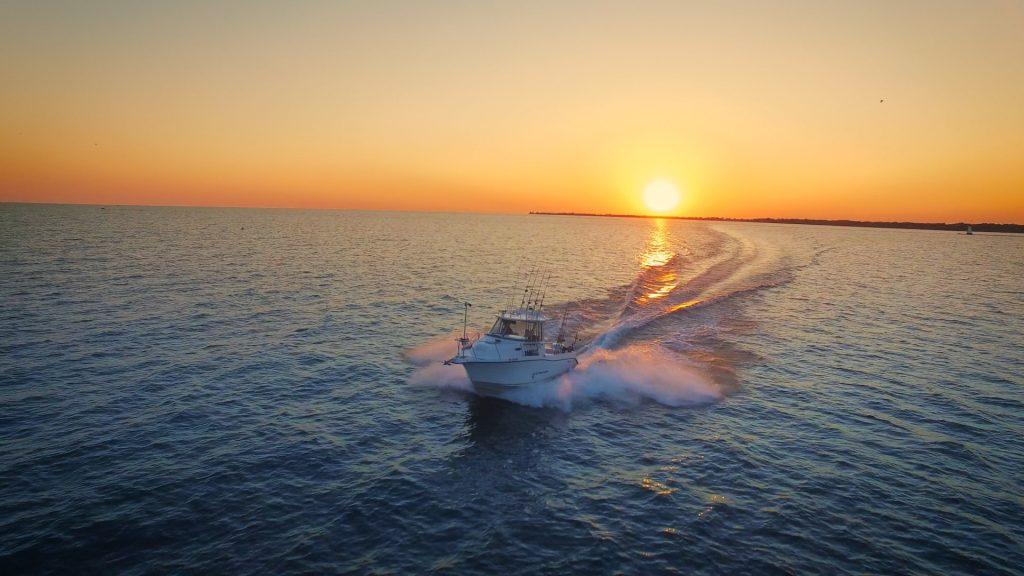 boat on water sunrise.jpg